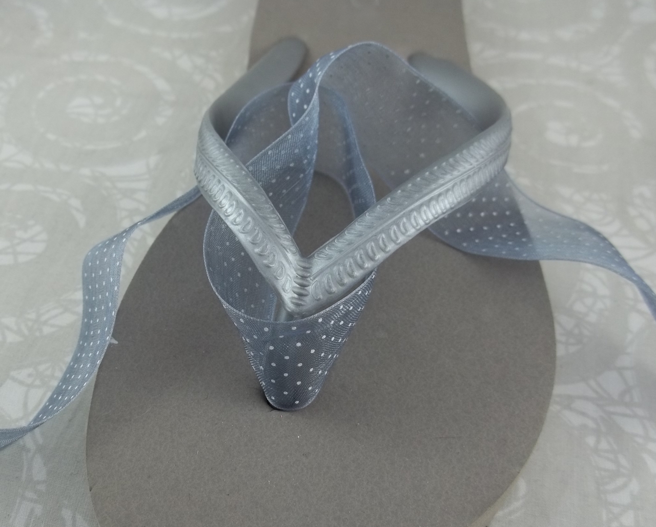 0efb7413569a Step 2 - Wrap the ribbon around the strap stem of the flip flop starting  from front to back and bringing it back to the front.
