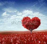 heart shape red colour tree ; red grass; blue sky