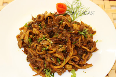 roasted calamari or kanava roast with yummy flavor of the spices a delightful lunch with this seafood meal is memorable