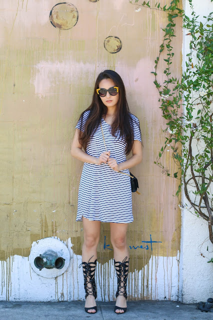 sensible stylista wears a striped dress