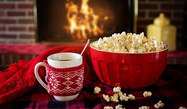Image: Popcorn in front of the fireplace, by Jill Wellington on Pixabay