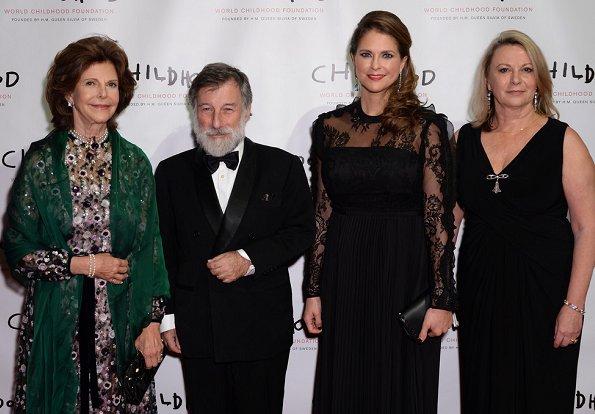 Monika Heimbold, Gunilla von Arbin, Joanna Rubinstein. Princess Madeleine wore a black gown Valentino for Childhood Gala