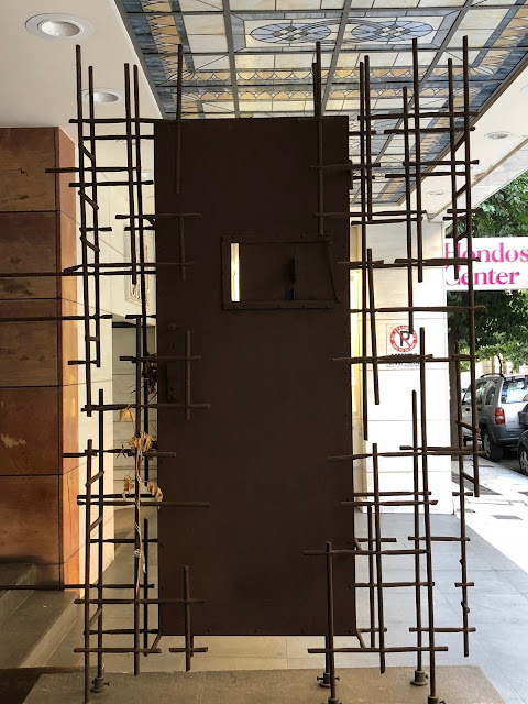 Gestapo Prison cell door at Gestapo Interagation Memorial Athens Photo gus619USA For Atlas Obscura