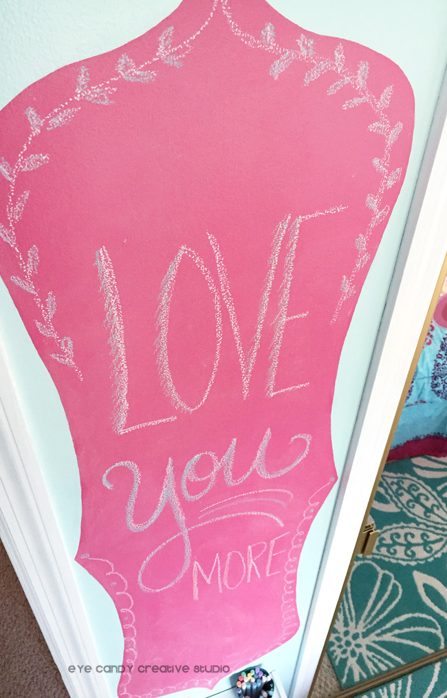 drawing on chalkboard wall, hot pink chalkboard, tween girls room makeover