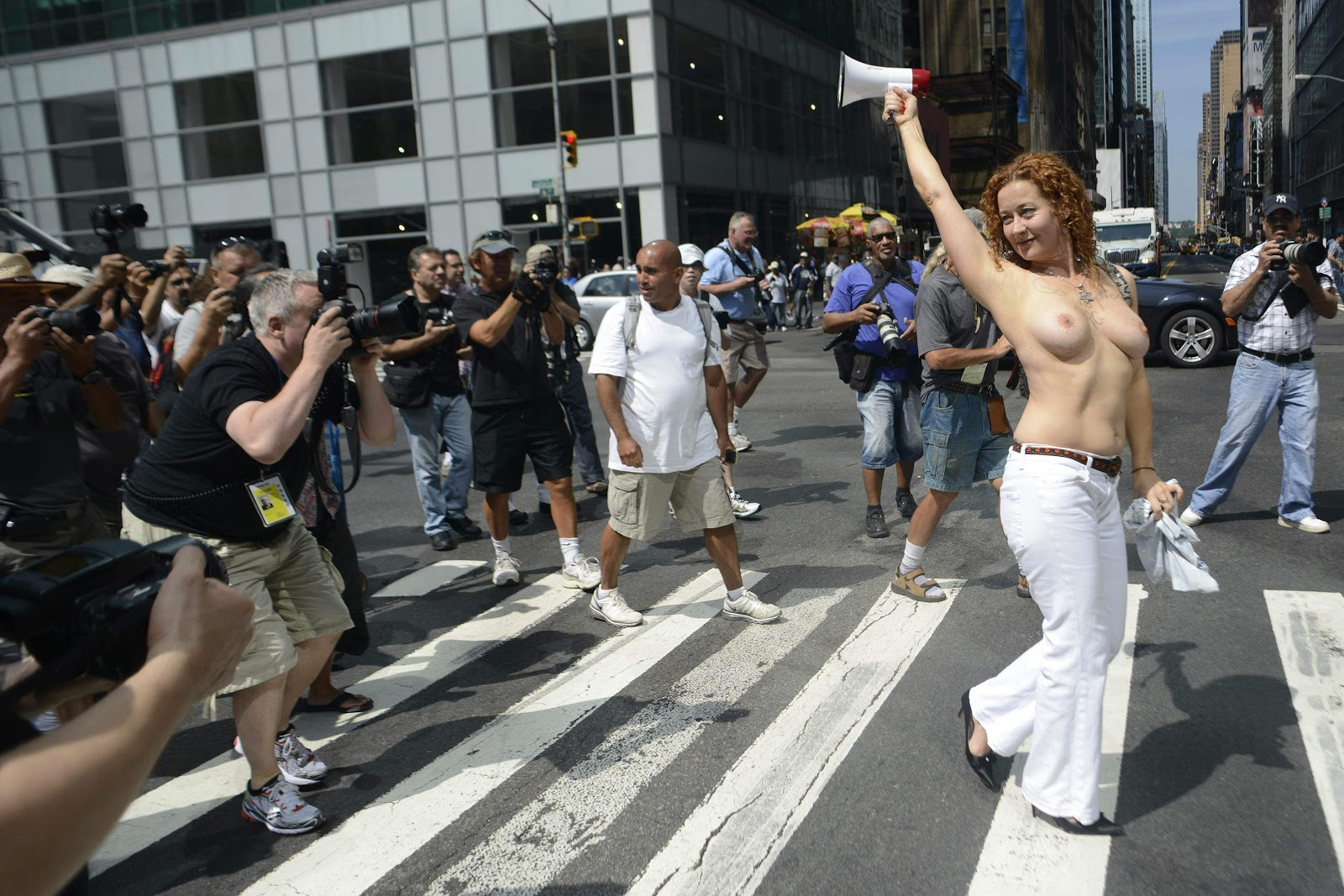Federal ruling allows women to legally go topless in six states