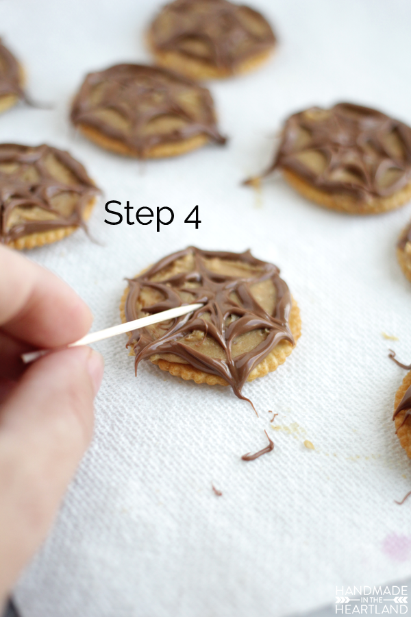 A super easy Halloween party snack, these chocolate peanut butter spider web crackers are perfect!