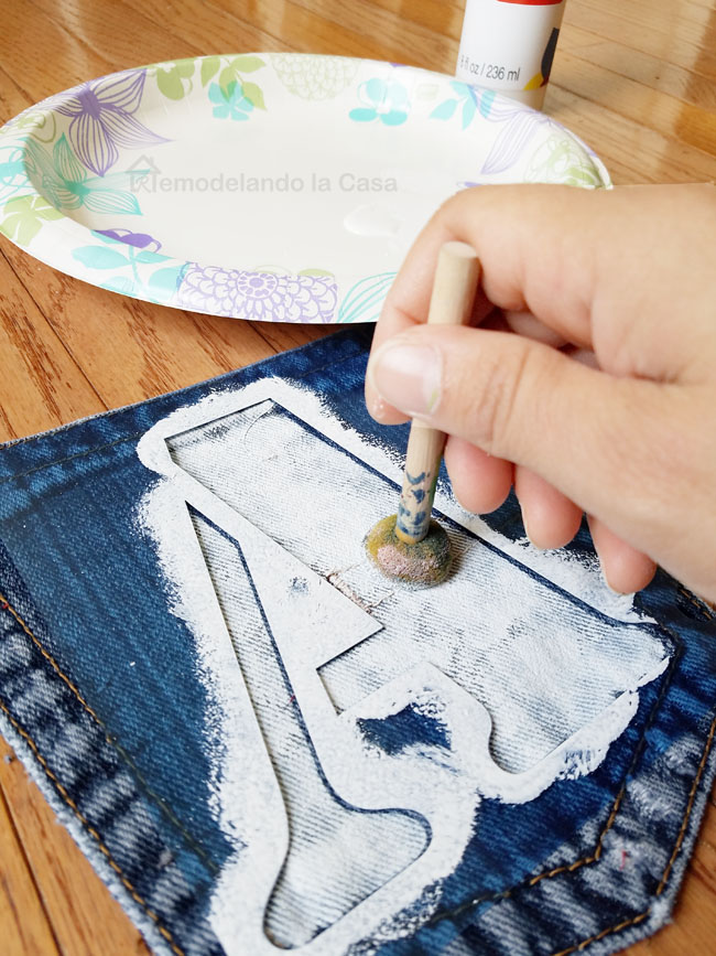 stenciling DAD on jean pockets - white paint