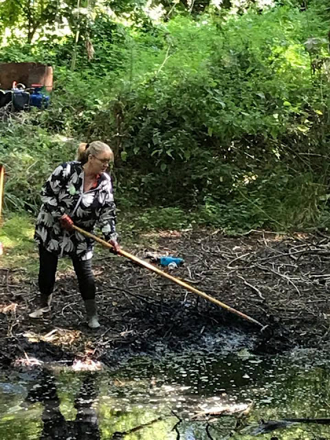 Julie Howell raking Debdale pond