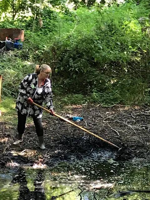 Julie Howell raking Debdale pond