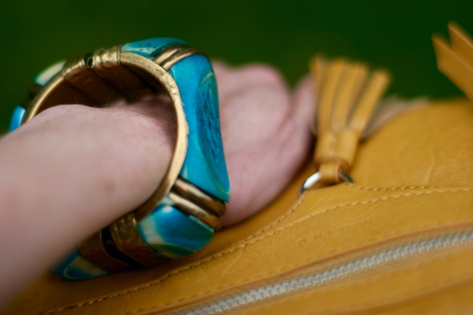 Vintage bangle and a yellow bag.