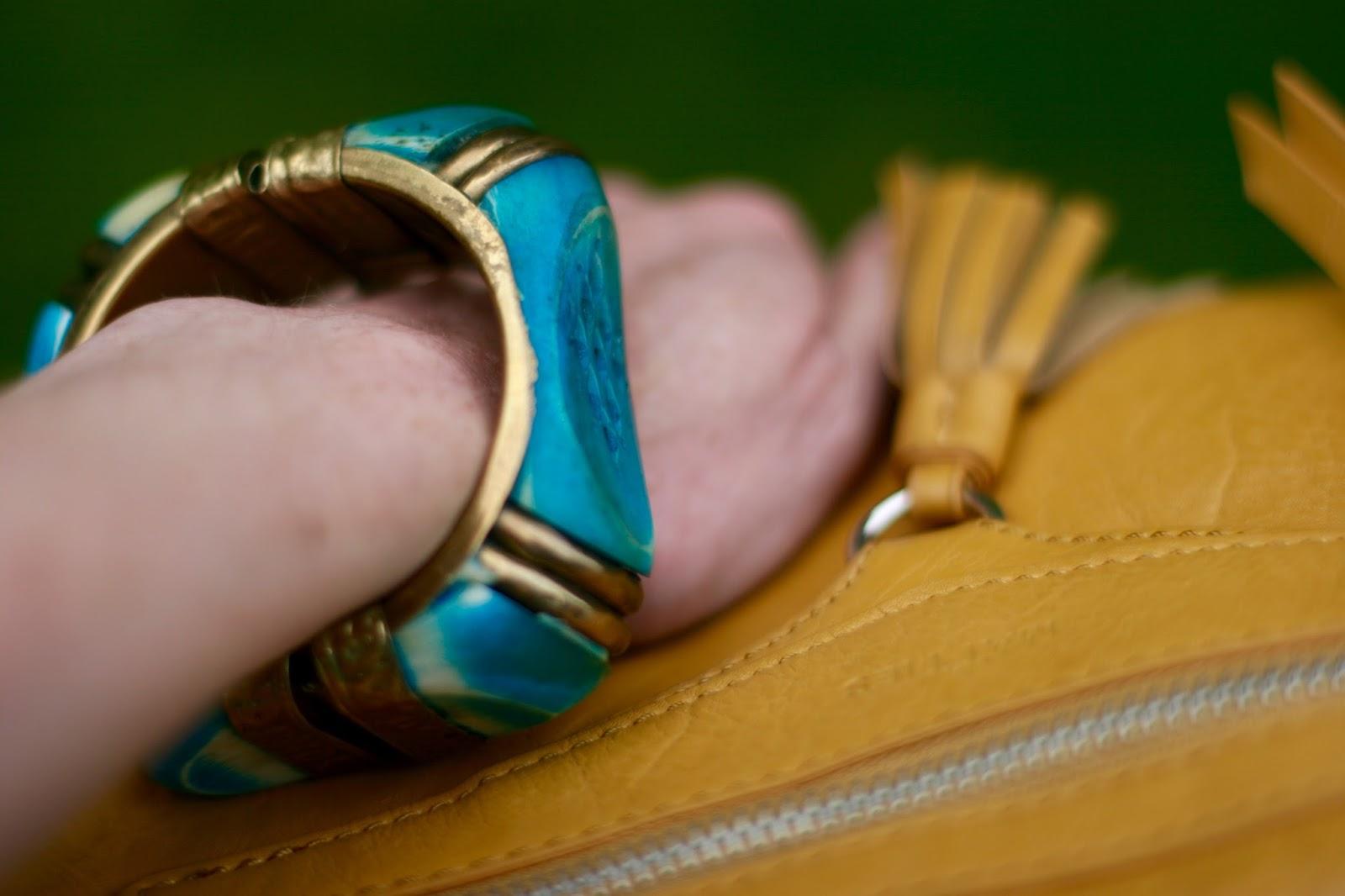 Vintage bangle and a yellow bag.