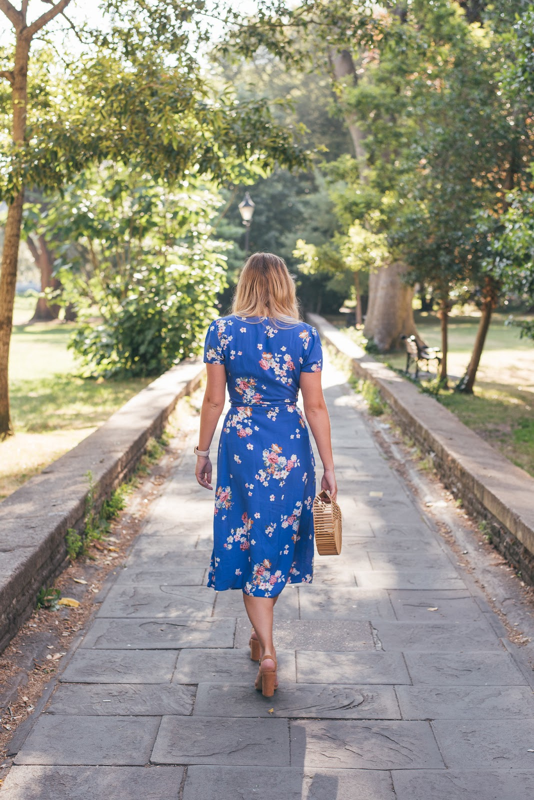 Rachel Emily Walking away from the Camera in Clifton wearing the Blue Midi Dress