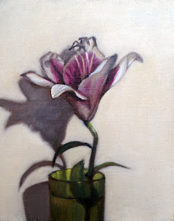 Oil painting of a white and pink lily in a green glass vase.