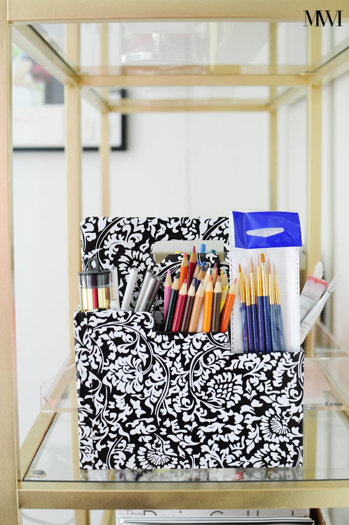 Use a wine or beer carrier to organize art, school or office supplies. Cover it with contact paper for a classy and fun look.