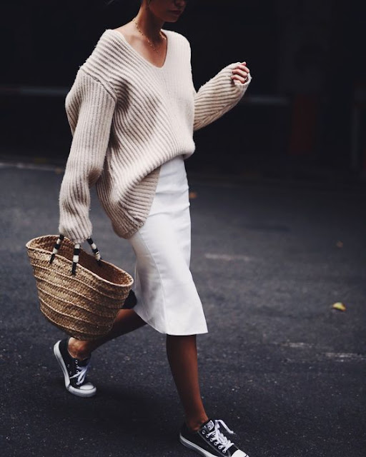 Oversized sweater tucked into pencil skirt, worn with sneakers and a big straw tote