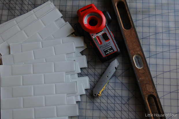 Supplies needed to add peel and stick subway tile