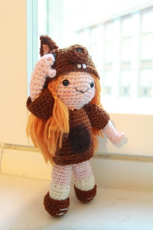 Amigurumi squirrel girl standing and saluting