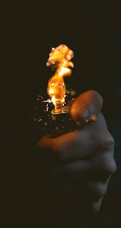 Fire at Hand Mobile HD Wallpaper