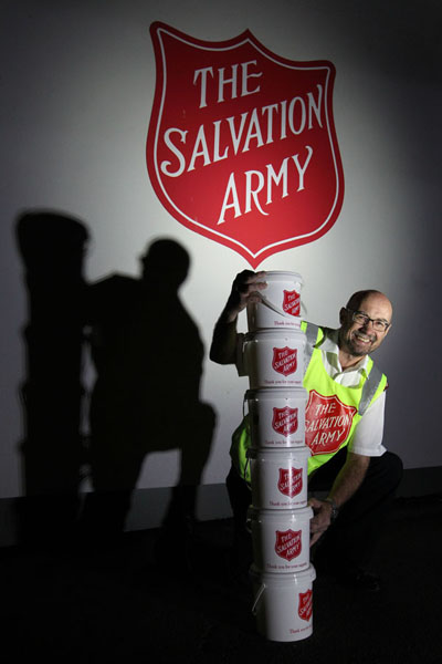 Major Alister Irwin, Salvation Army Napier, Napier, with collection buckets for the annual Red Shield Appeal. photograph