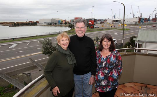 "L-R: Gillian Wilton, Bruce Wilton, Sandy Anderson (their neighbour), pictured at the Wilton's home, 3 Breakwater Rd, Napier, with Napier Port in the backgroound. ""Napier Port and its neighbours have negotiated a break-through in their long-running bid to address noise issues, agreeing on a fresh approach involving acoustic treatment for some homes."" photograph"