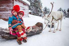 Mother and daughter in the snow with reindeer - Sami People
