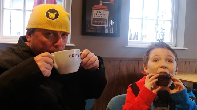 Father and son enjoying a Costa