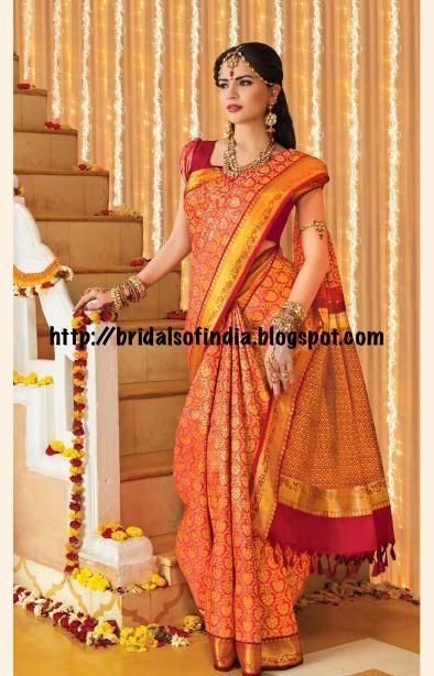 f65c32c812e94 Rich maroon and gold wedding silk saree in a floral pattern. - RmKV Silks