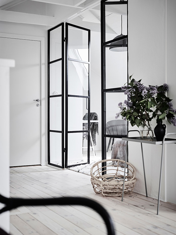Attic bedroom with black metal frame door divider. Photo by Anders Bergstedt