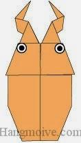 Bước 14: Vẽ mắt để hoàn thành cách xếp con bọ cánh cứng stag beetle bằng giấy theo phong cách origami.