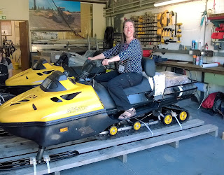 Carol trying out a snowmobile at the British Antarctic Survey