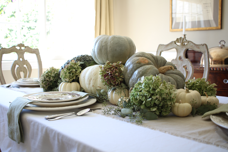 neutral fall tablescape with green pumpkins and dried hydrangeas