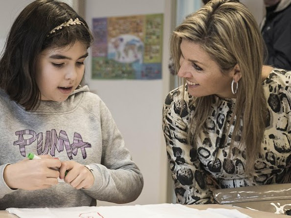 Queen Maxima of The Netherlands visited the IMC Weekendschool in Haarlem. Queen Maxima wore Natan Dress