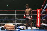buakaw stand like a boss after KO his opponent