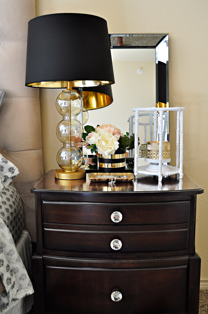 Decor ideas for making a master bedroom in an apartment or rental more glam using black, white and gold accents. | via monicawantsit.com