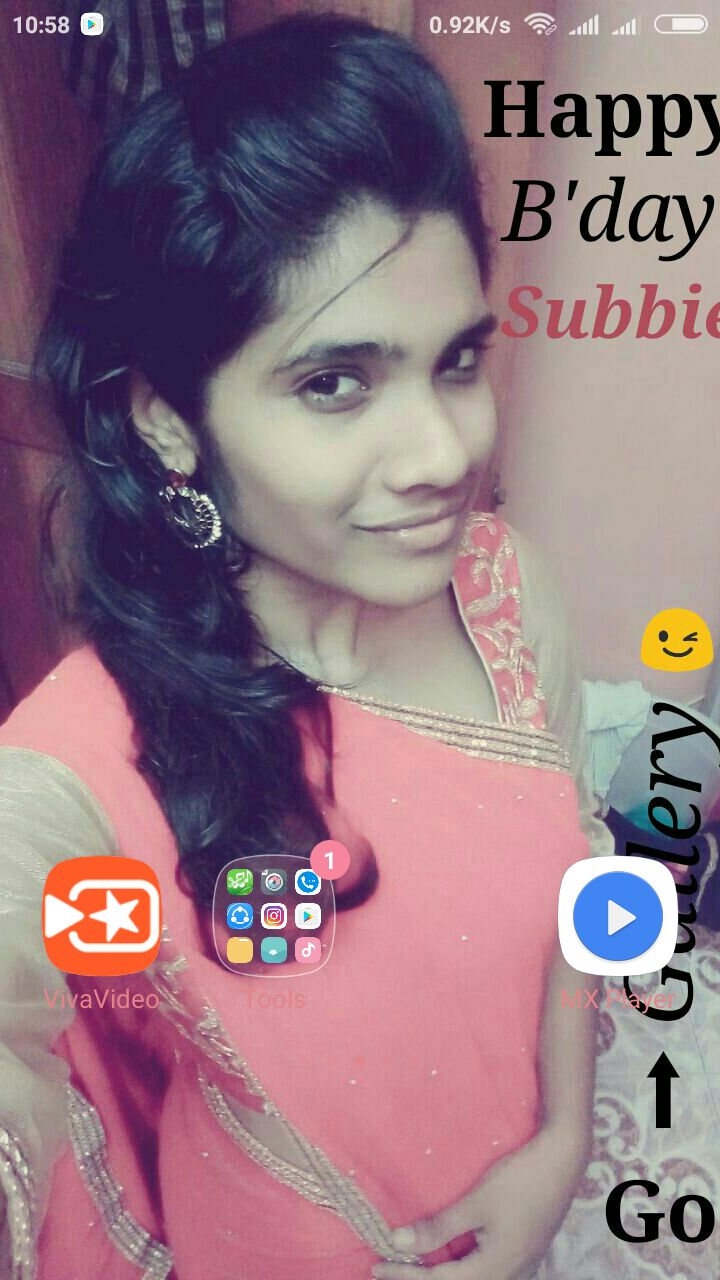 she did and was surprised to see a mobile wallpaper was her wearing saree with quotes on it stating go to gallery and watch the video