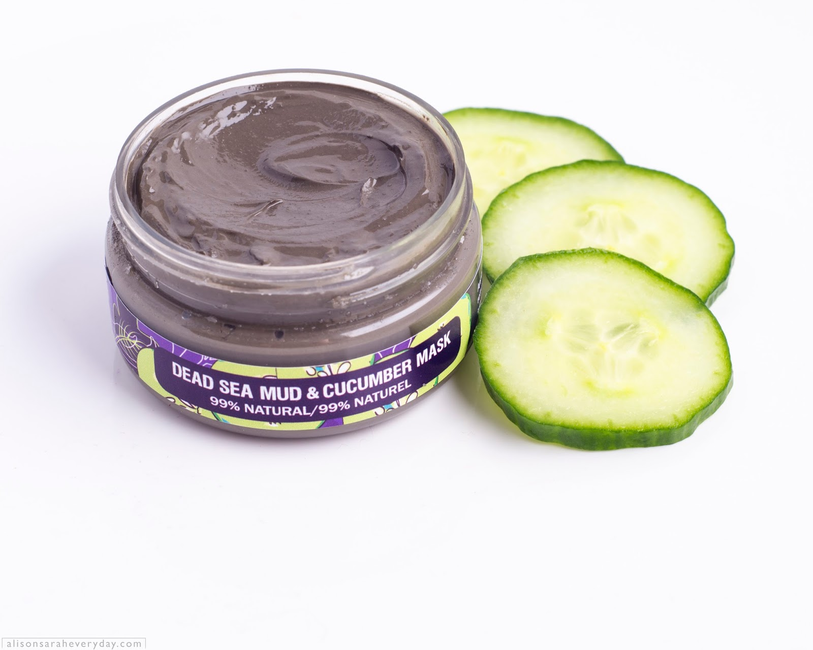 Purple Urchin Dead Sea Mud & Cucumber Mask with the lid off on a white background with cucumber slices