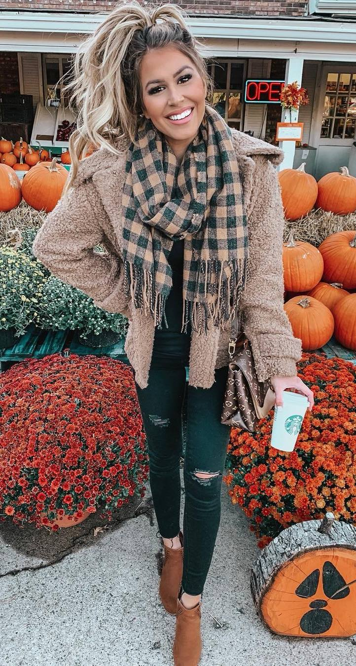 cozy fall outfit / brown boots + ripped jeans + bag + scarf + beige fur jacket