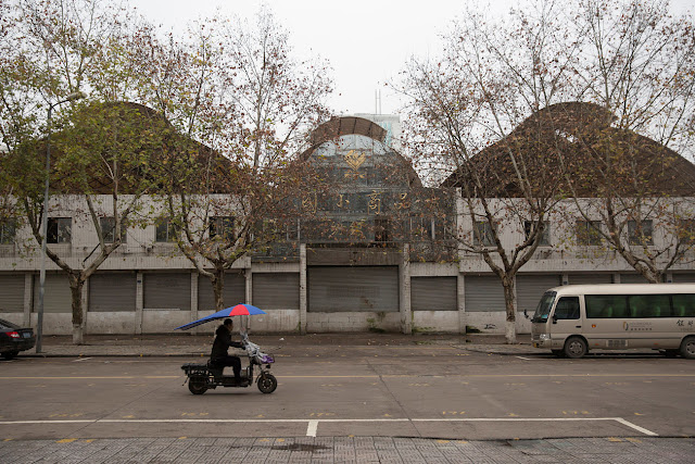 A motorcycle passes a closed-down warehouse in Yiwu, Zhejiang Province,China 19 January 2017. To match story CHINA-MIGRANTS/MIDEAST Thomson Reuters Foundation/Shanshan Chen