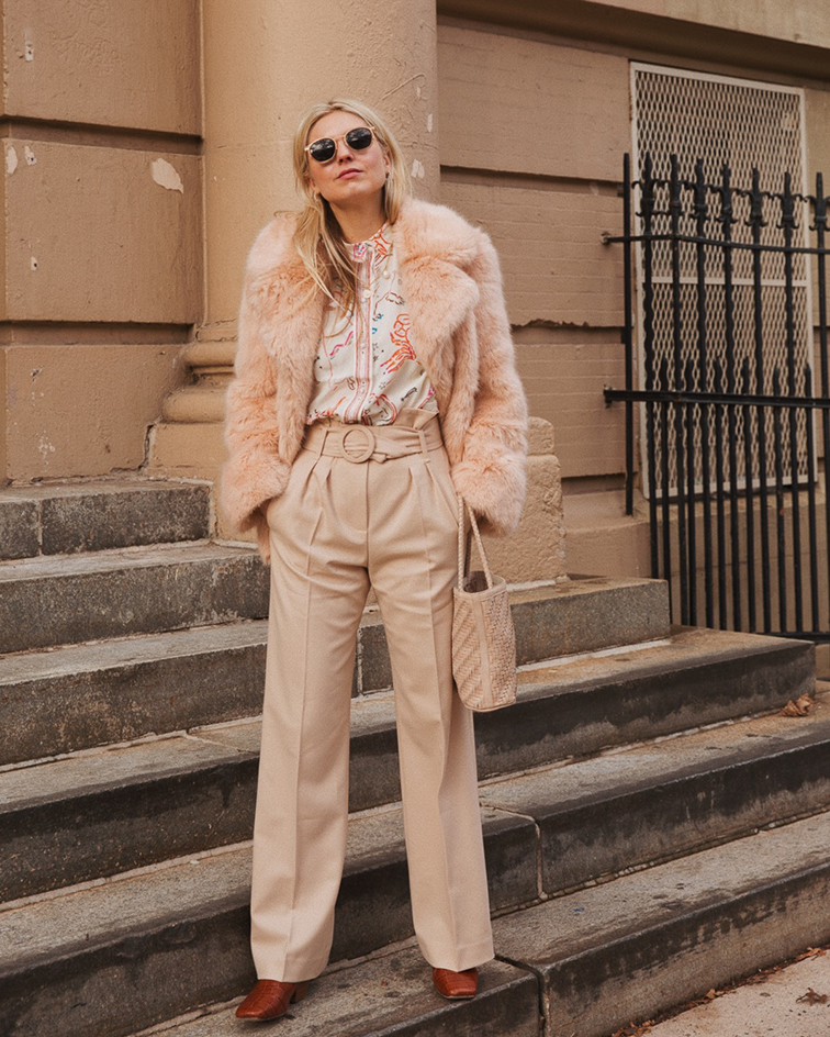 sezane zodiac astrology  blouse, stella mccartney faux fur coat, nanushka boots, bembien braided leather bag, warby parker x chloe sevigny tate sunglasses