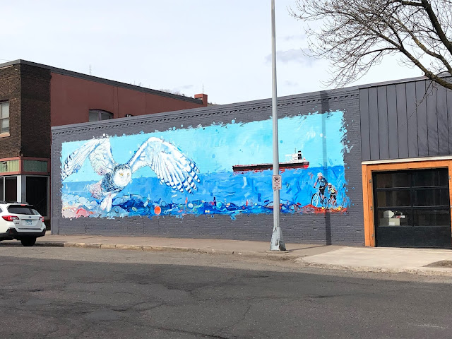 Beautiful mural of a snowy owl and Lake Superior by Adam Swanson in Duluth's Our Lincoln Park.