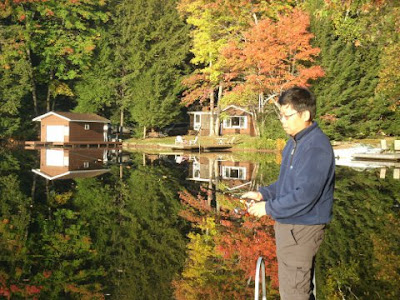 Me fishing with fall colours Lake Muskoka Thanksgiving 2011 by garden muses: a Toronto gardening blog
