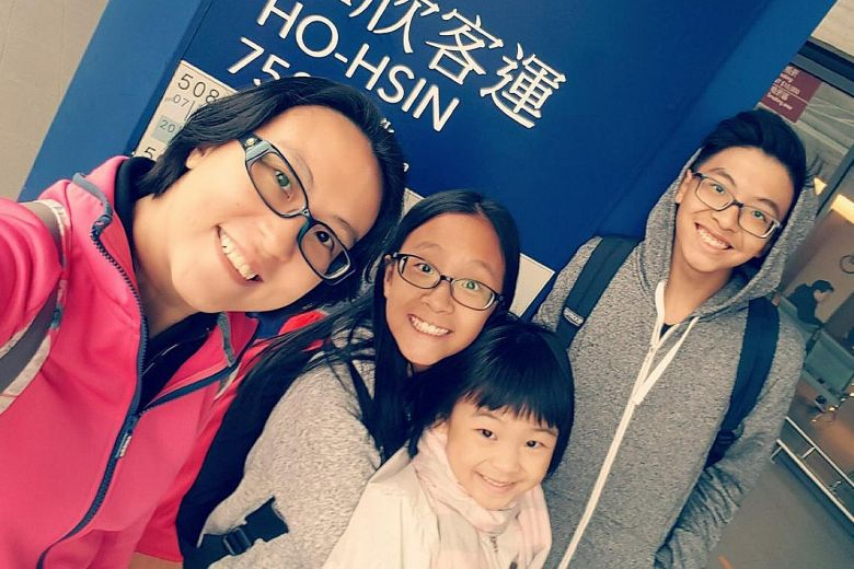 Ms Serene Lee (left) with her children Jasher, 14, Jazaree, seven, and Joash, 17. The photo was taken in March last year during her first trip to Taiwan with a new heart.