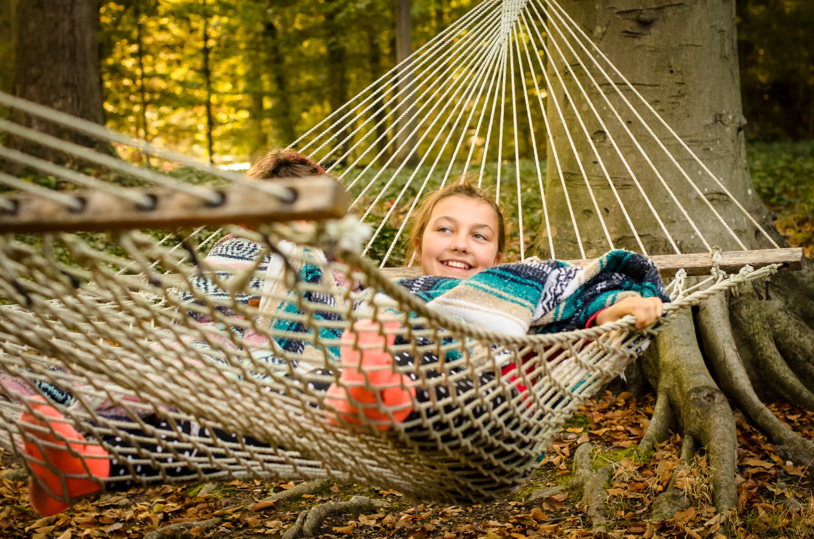 homeschooling family boy and girl in hammock in the woods ©Diana Sherblom Photography