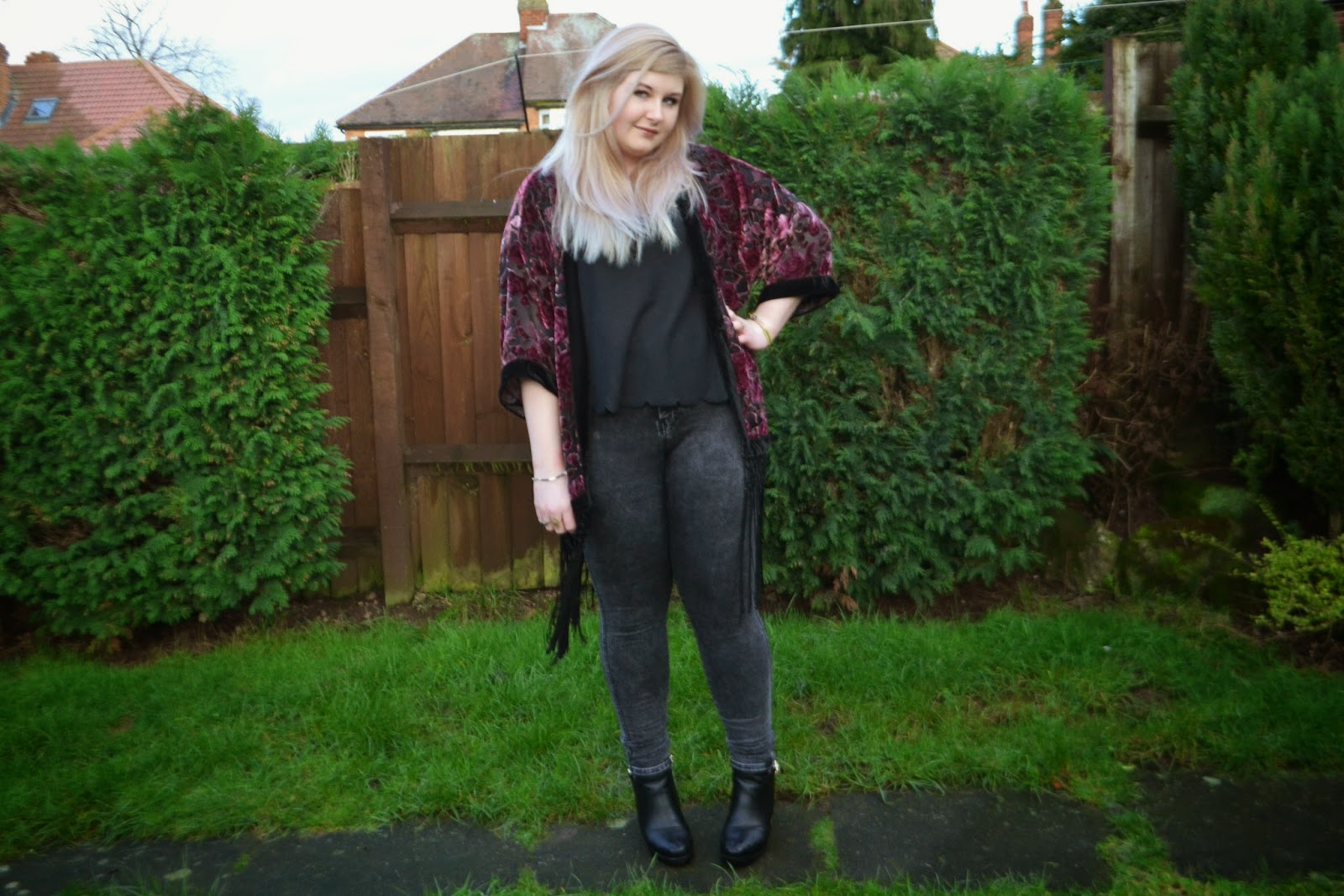 Full body outfit shot showing me wearing a black top, grey jeans, heeled boots and a deep pink kimono