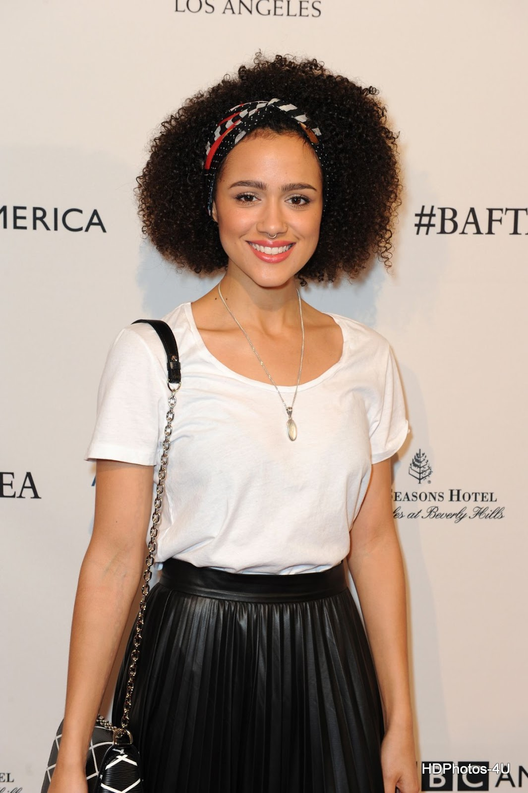 HD Photos of 'Fast 8' actress Nathalie Emmanuel at BAFTA Los Angeles Awards Season Tea in Los Angeles