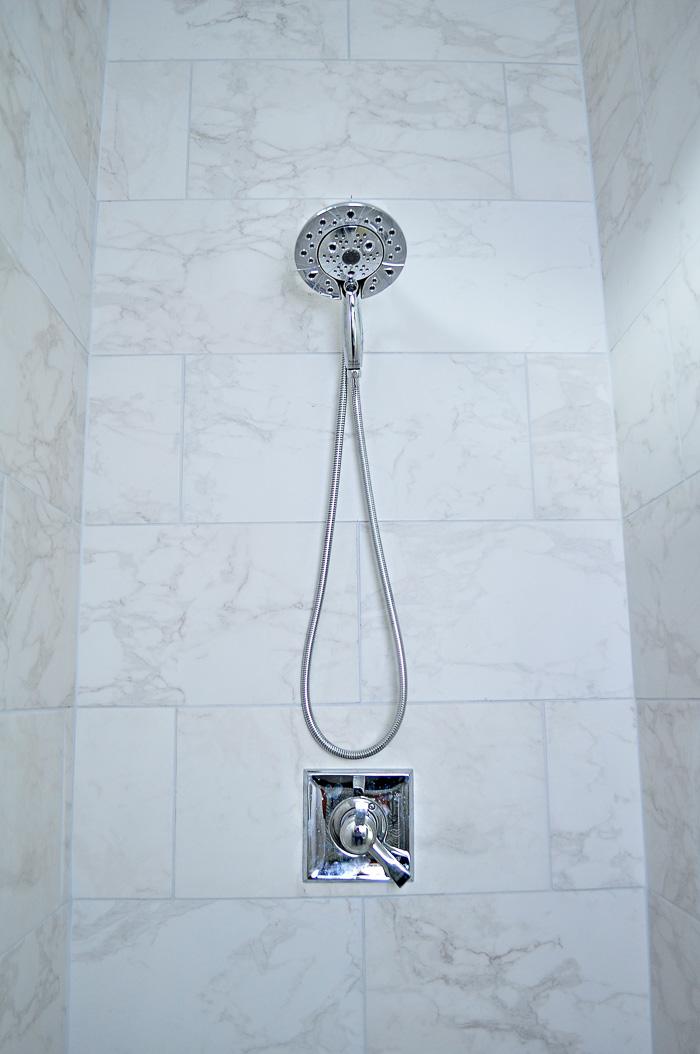 Marble tiled 12x24 shower with chrome fixtures. | via monicawantsit.com