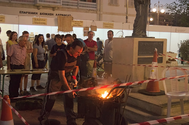 A blacksmith creating and manipulating objects using fire in Limassol, Cyprus during Kataklysmos - festival of flood.
