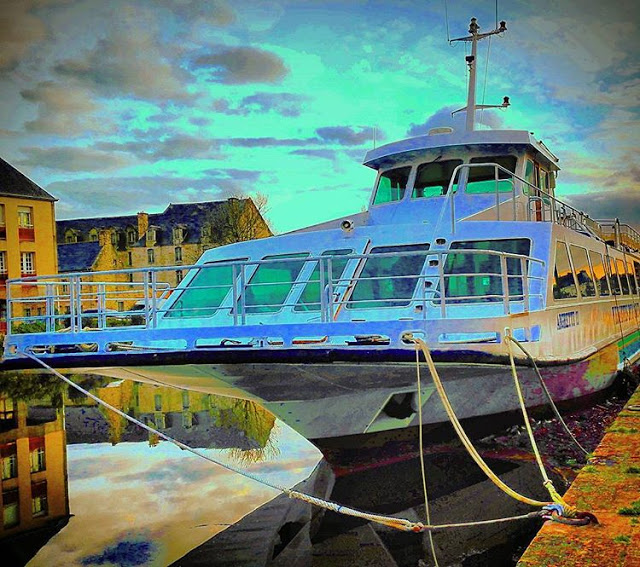 A big yacht is standing in the water of Odet River in Quimper