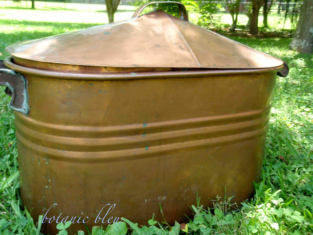 Antique copper pot with lid is perfect for hydrangeas in summer and firewood in winter