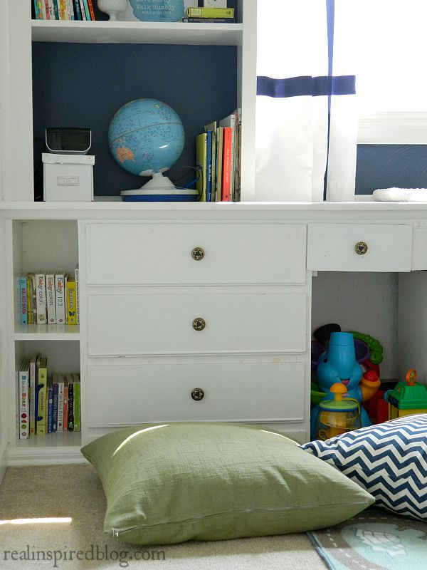 A boys' vintage modern nursery reveal! A simple makeover using a primary color palette to unify everything from toys to vintage heirlooms and sentimental objects. DIY floor pillow for kids